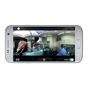 Mobile phone playing 360 video of surgery